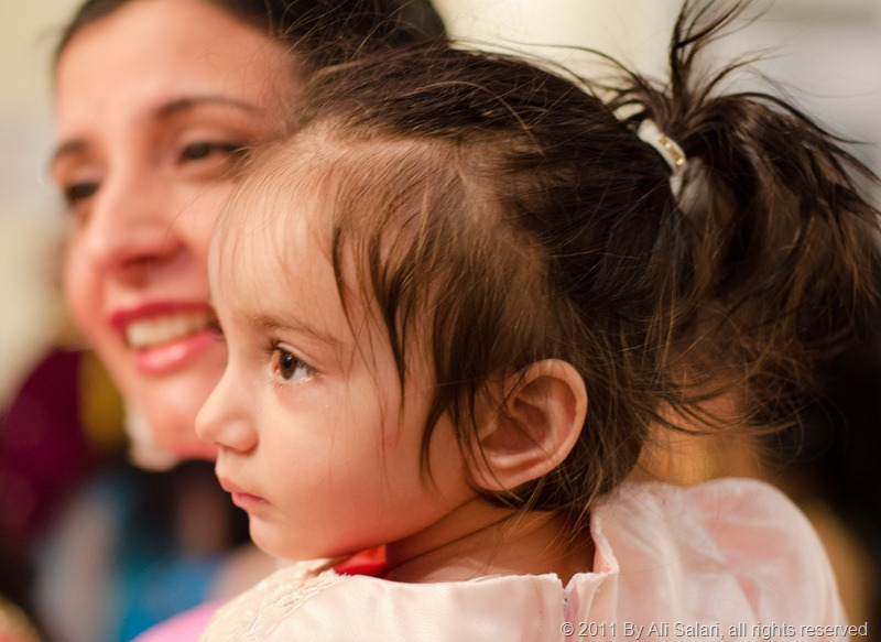 Picture of a mother holding her daughter at a wedding