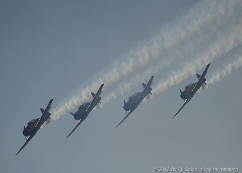 4 Harvard airplanes flying in formation