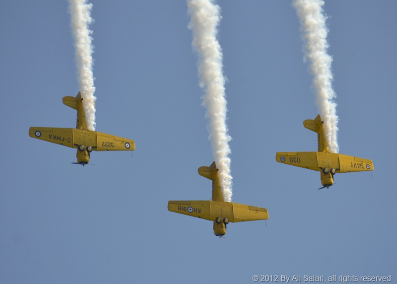 3 Harvard aircraft flying straight down, showing their bottoms